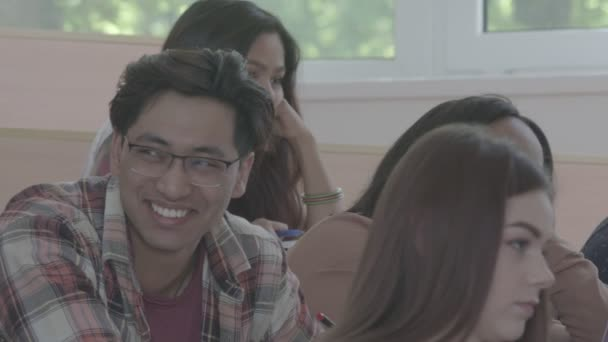 Students laughing during university lesson.