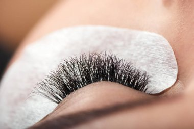 Close up of long enlarged woman s lashes.