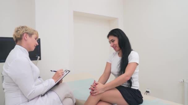 Patient explaining problem to doctor.
