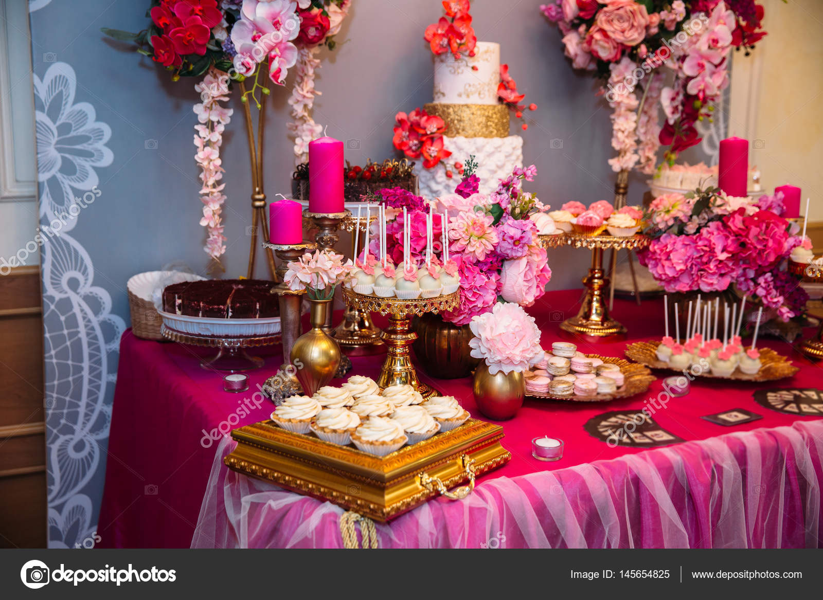 Sweet multilevel wedding cake decorated with beautiful flowers ...