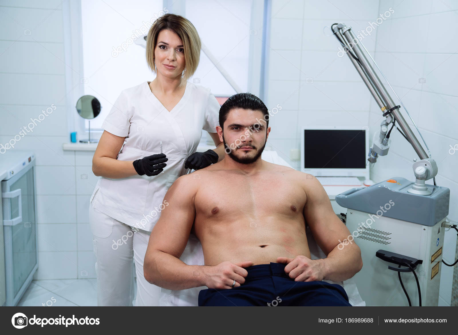 Male patient and cosmetologists hands with syringe during