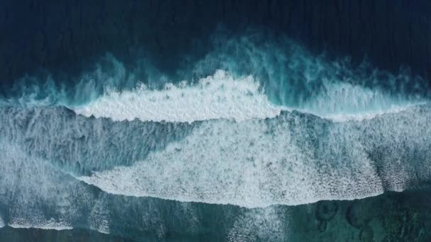 Slow-motion top down air view of the ocean giant waves, foaming and splashing