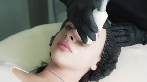 Close-up, woman on facial moisturizing procedure in cosmetology clinic