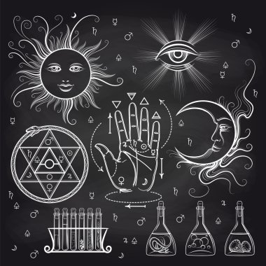 Isoteric and alchemy elements on chalkboard