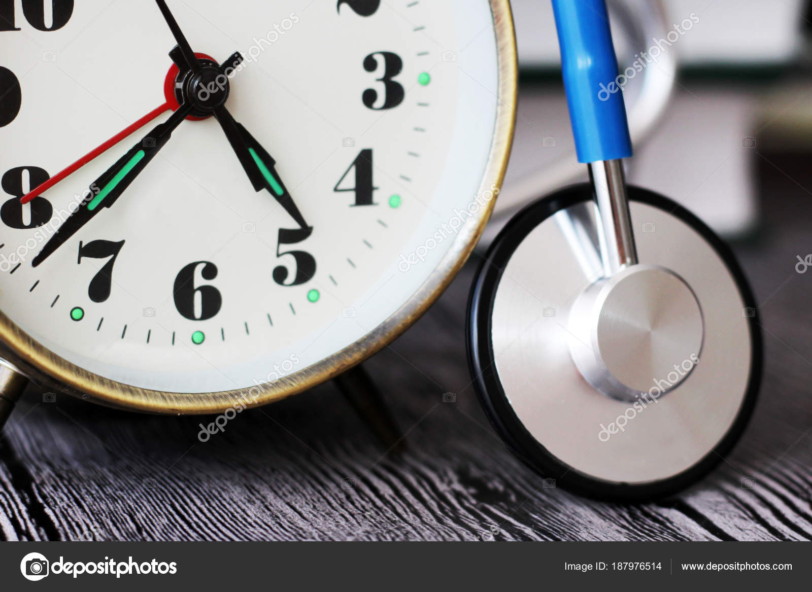 clock doctor watch and stethoscope medical stock photo