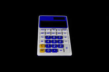 Calculator on black background close up. Business, electronics, office