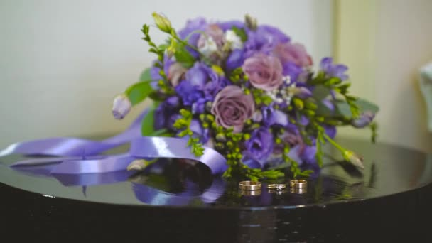 Beautiful Wedding Ring and Bouquet on the Table
