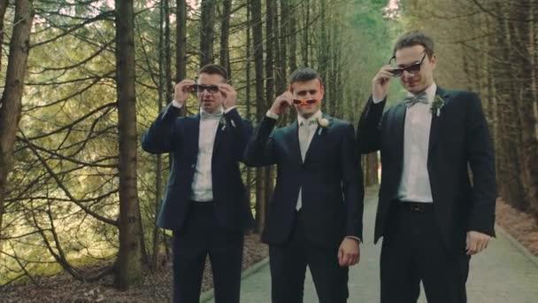 Three Male Wearing Glasses