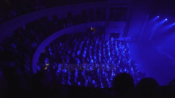 People applauding at concert