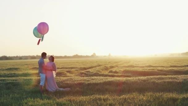 loving couple kisses at sunset