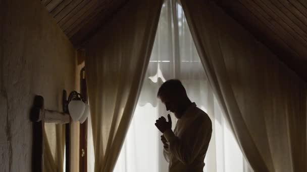 Silhouette of a man wearing a shirt