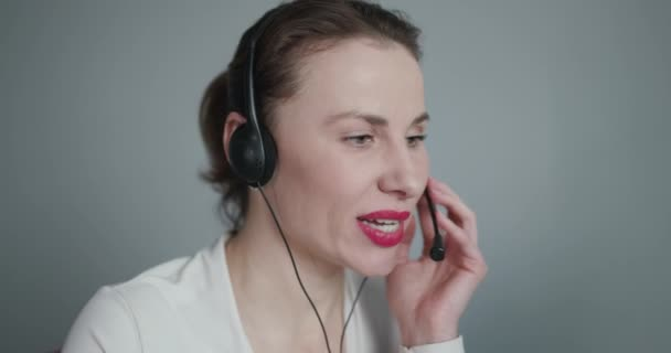 Support and Operator Service Business Representative Concept. Young Beautiful Women Call Center Wear Headset and Working with Computer while Consulting Customer with Online Problem.