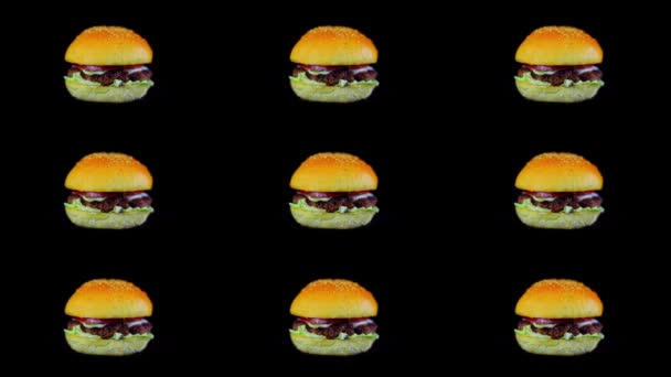 Set of Nine Rotating Hamburgers on Black Isolated Background
