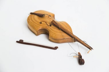 Old vintage wooden broken violin with bows on white background.