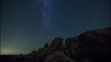 Large Stones Of Different Shapes Lying Under The Starry Night Sky View