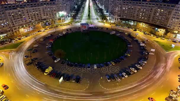 the Movement of Cars in a Circle, Roundabout Road at Night Bucharest. View of the City From on High. on the Road Going Car With Headlights Included.