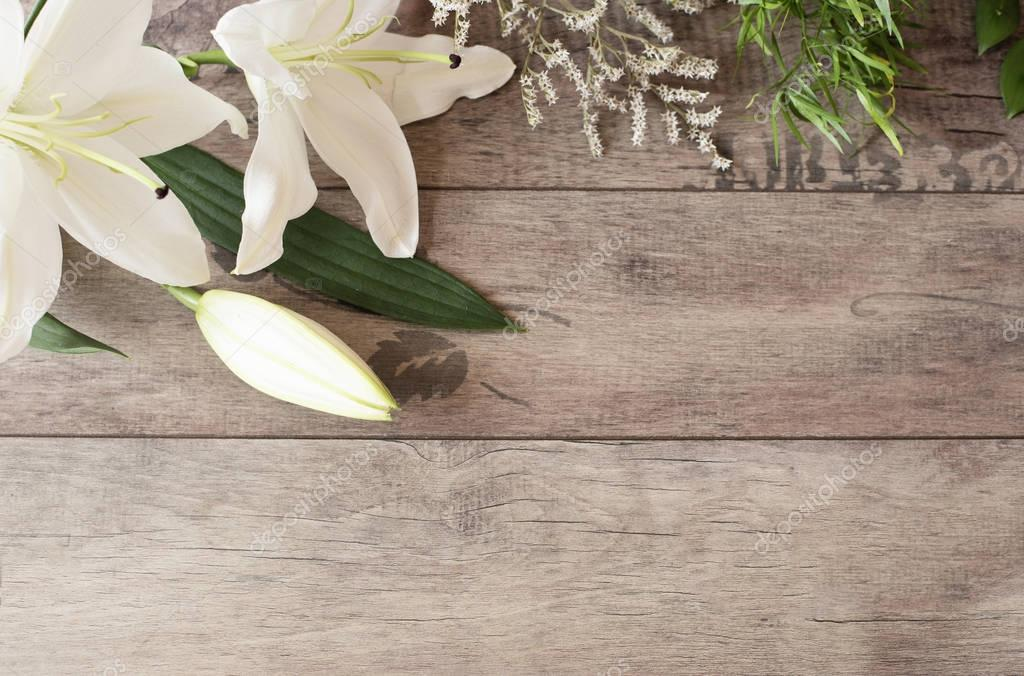 Floral frame with white calla, lilies on wooden background. Styled ...