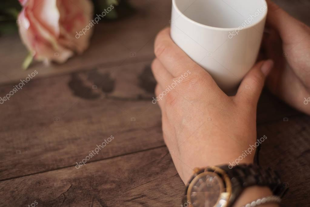 Girl is holding white cup in hands. White mug for woman, gift ...
