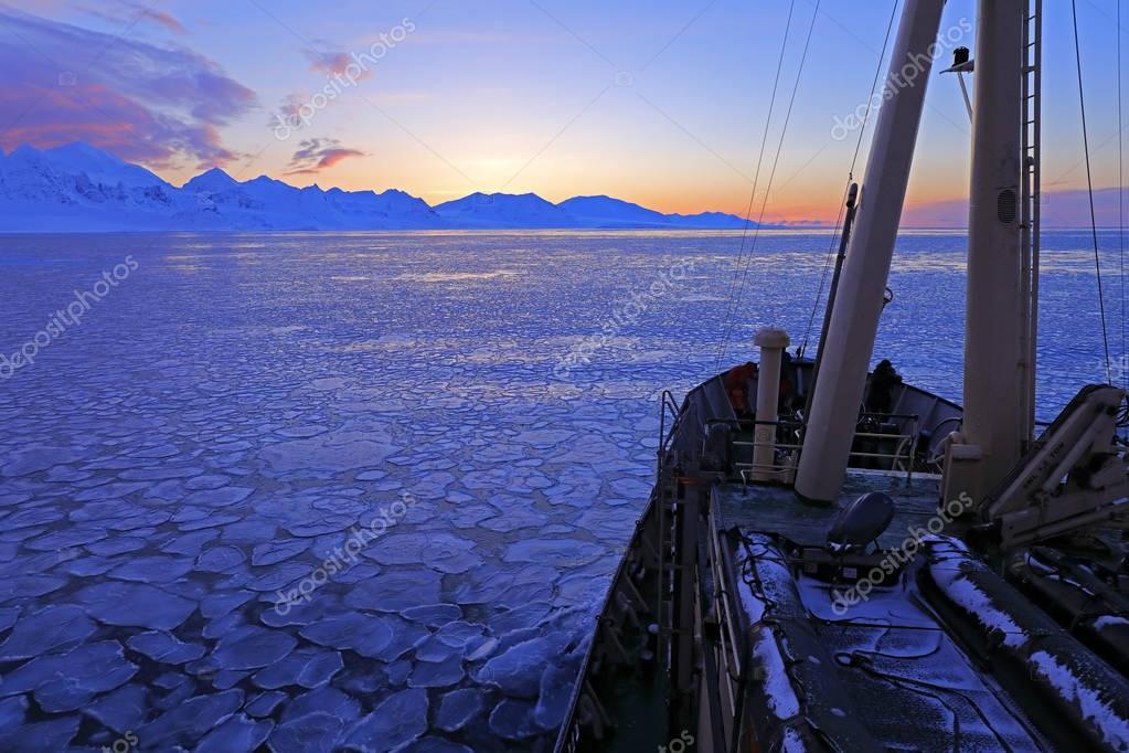 Boat in winter Arctic