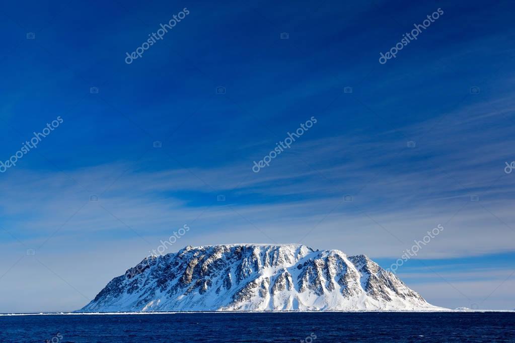 Rocky island with snow