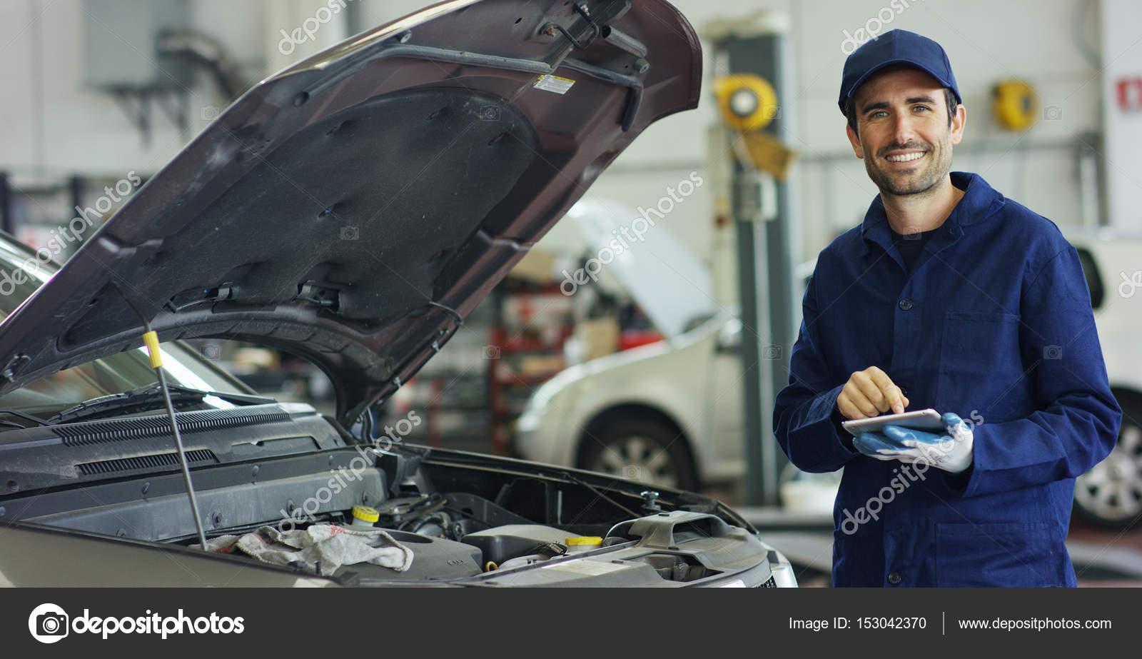 Specialist auto mechanic in the car service, checks the ...