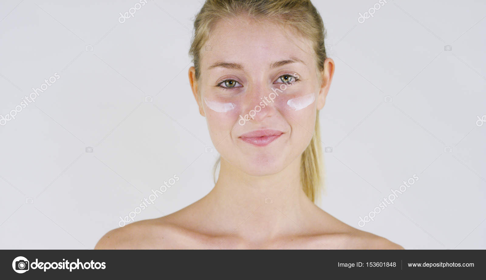 Portrait of a beautiful young girl smiling and looking at the camera looking at the camera without makeup smearing face of creamon a white backgroundnceptnatural beautyyouthskin care always younglove yourself solutioingenieria Image collections