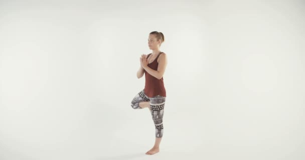 Young blond woman performing yoga
