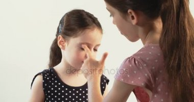 Little girls playing with makeup
