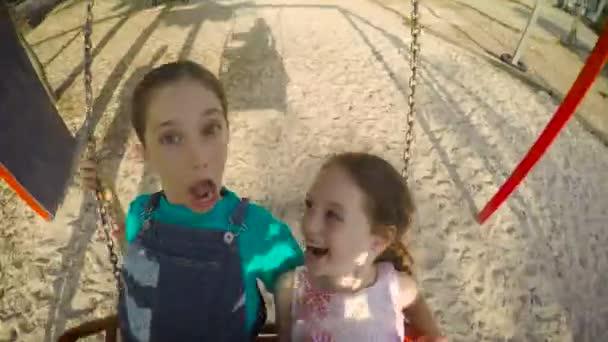 cute little girls swinging