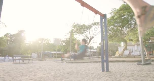 kids swinging on swing
