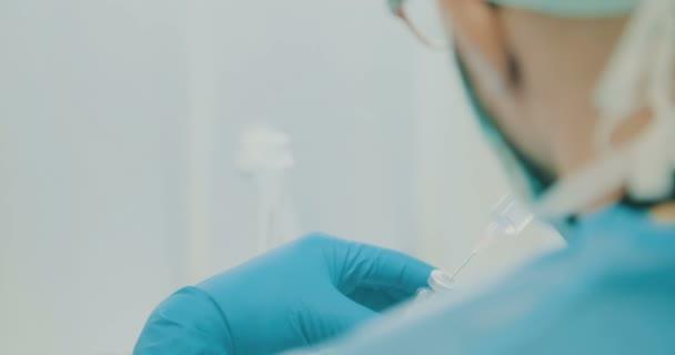 Oncology pharmacist preparing chemothrapy drugs