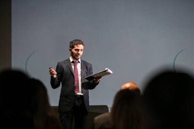 Public speaker giving talk at Business Event