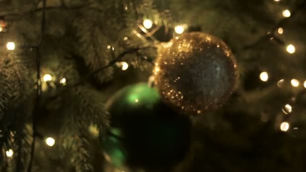 christmas decorations on a big green tree stock video - Big Christmas Decorations