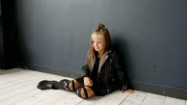 little girl model sitting on the floor