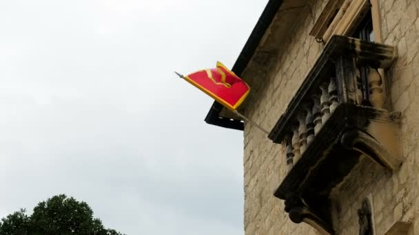 red flag of Montenegro hangs on a house