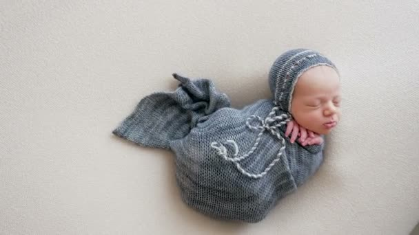 newborn baby boy swaddled sleeping
