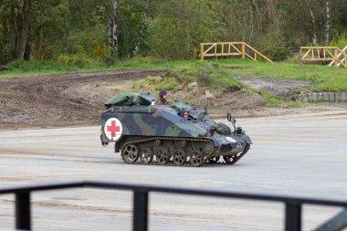 german Wiesel, medic version from Rheinmetall stands on platform near battlefield