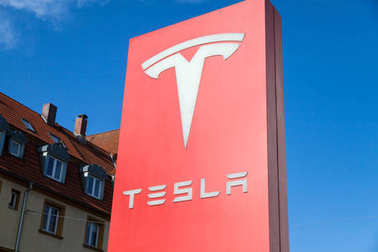 FUERTH / GERMANY - MARCH 4, 2018: Tesla logo near a car dealer. Tesla, Inc. is an American company that specializes in electric automotives, energy storage and solar panel manufacturing.