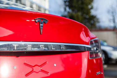FUERTH / GERMANY - MARCH 4, 2018: Tesla logo on a Tesla car Tesla, Inc. is an American company that specializes in electric automotives, energy storage and solar panel manufacturing.