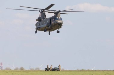 BERLIN / GERMANY - APRIL 28, 2018: Military transport helicopter Chinook from Boing Rotor Craft Systems flies at airport Berlin / Schoenefeld.