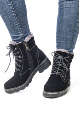 demi-season women's boots black on the feet in jeans on a white background