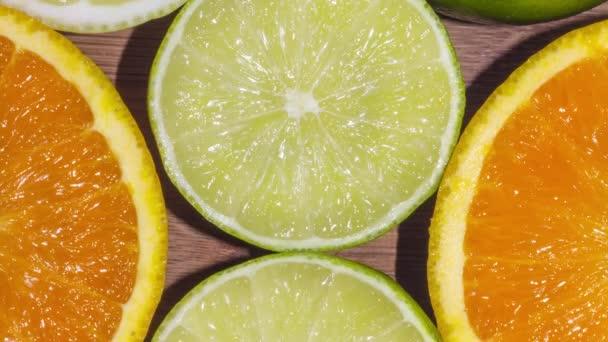 Posunutí nad pozadím pomeranče, limetky a citrony snížit na polovinu a odhaluje jejich rozmělní na bezešvé smyčka cyklus