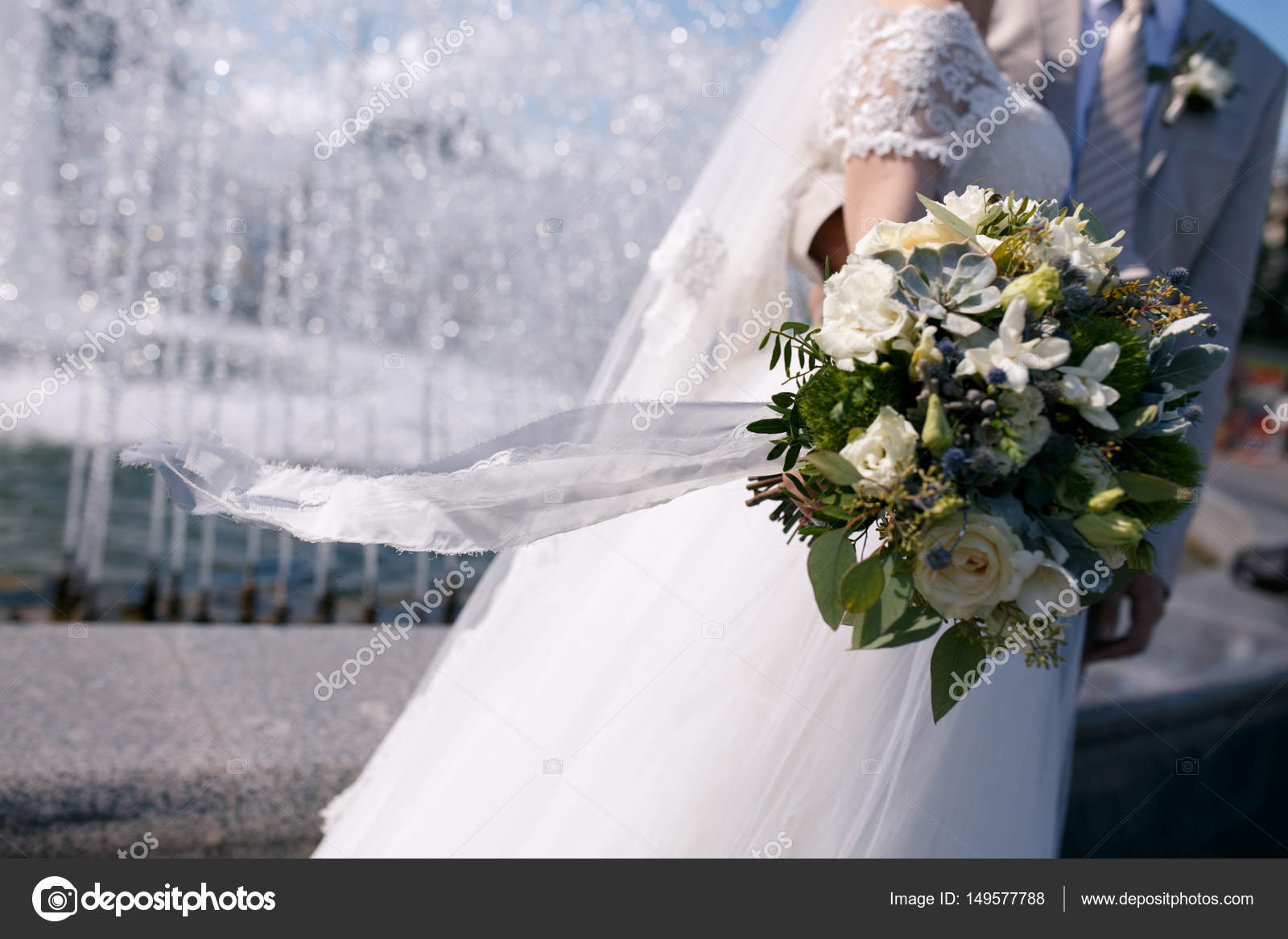 Green And White Wedding Bouquet In Hands Of The Bride With A