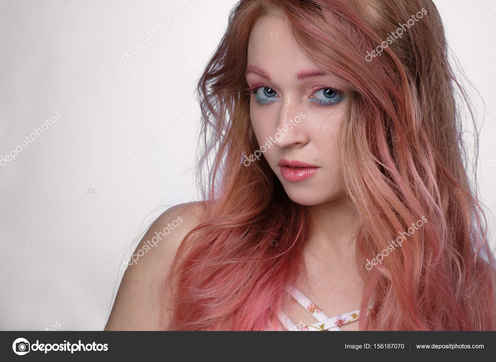 Close Up Portrait Of Girl With Pink Hair And Pink And Blue Make Up