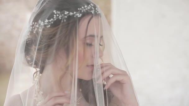 beautiful young woman bride wearing veil posing in studio