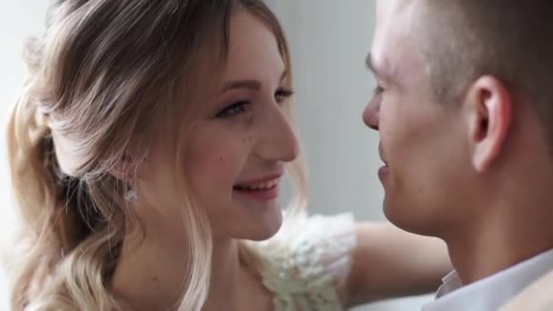 young beautiful bride and groom posing in studio