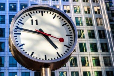 Clock Against Office Building