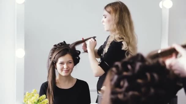 stylist working in a beauty salon and a nice lady