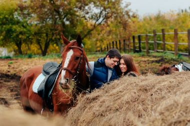 young couple in a Russian village with horses, riding 1