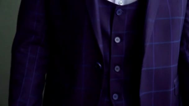 details of the groom's jacket at the wedding